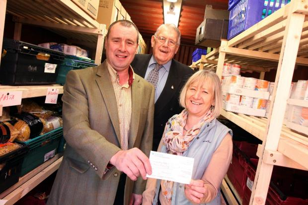 Chris Bown, right, of the Salvation Army, receives a cheque from Chris Rushton, left, and Leslie Allinson, of Royal Lodge Number 265 – a Keighley Freemason's lodge – to help pay for a         container to  store foodbank products