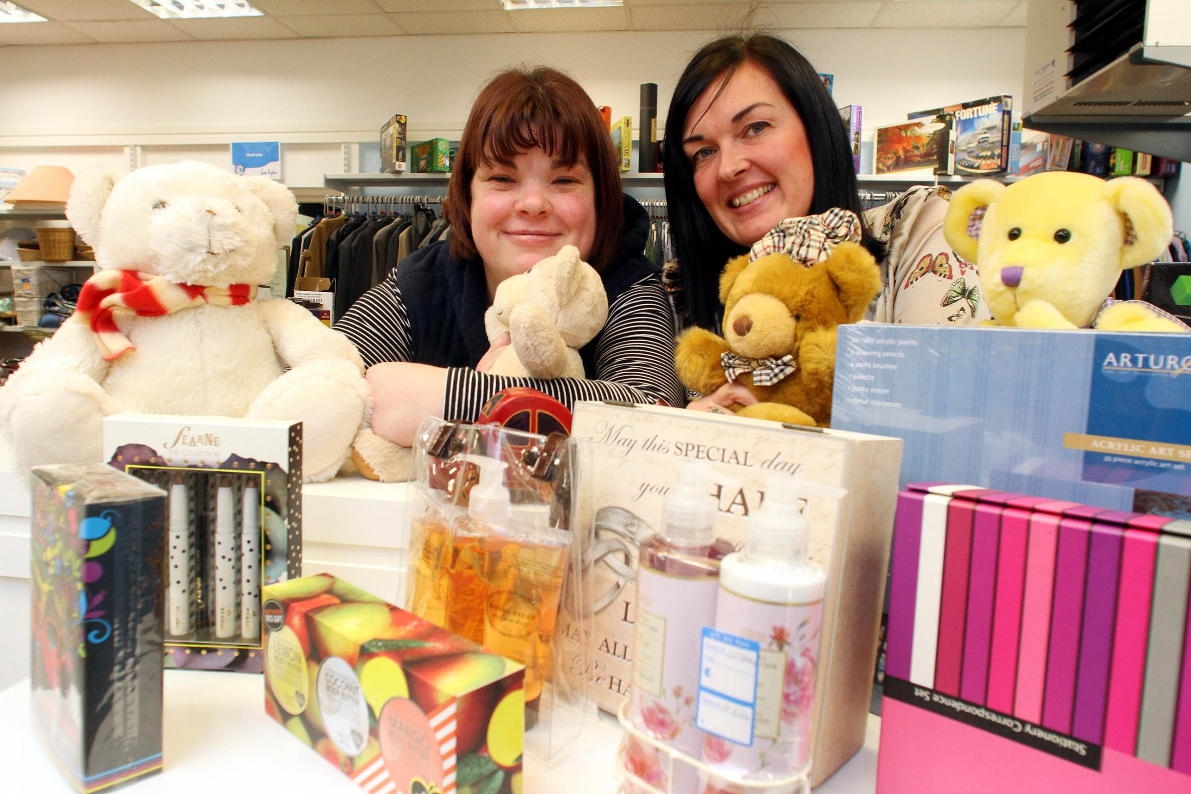 Manorlands Keighley shop manager, Jackie Burke, right, and volunteer Helen Lumbers show items from the Christmas present amnesty