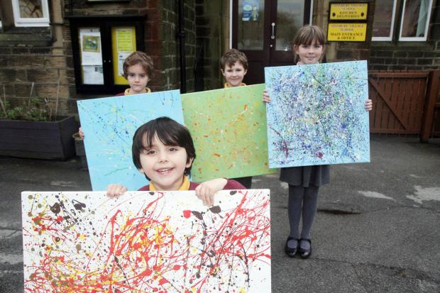 Showing off some of the artwork at Stanbury Primary School, inspired by Jackson Pollock, are, from left, Tom Jalil, Patrick Bailey, Oscar Booth and Niamh Green