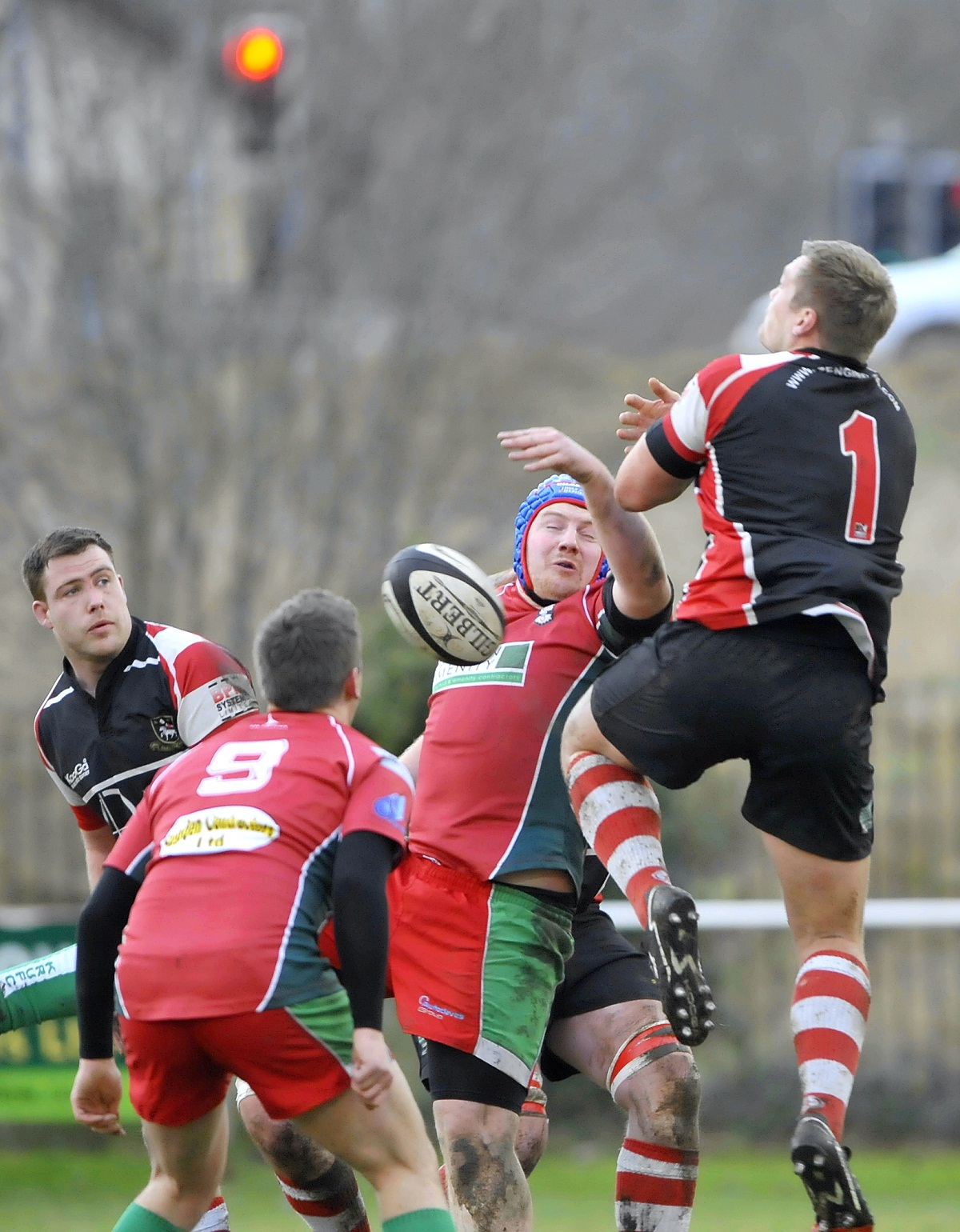 Keighley survived the late sin-binning of prop Craig Spencer (blue scrum cap) to claim a vital away win