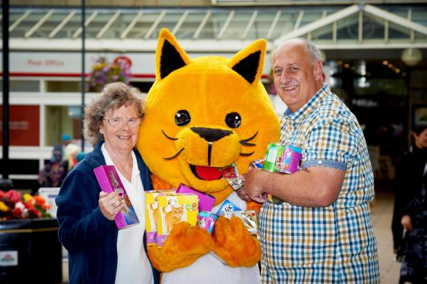 Airedale Shopping Centre manager, Steve Seymour, with Haworth Cat and Rita Raby, trustee and volunteer from last year's chosen charity, Yorkshire Cat Rescue