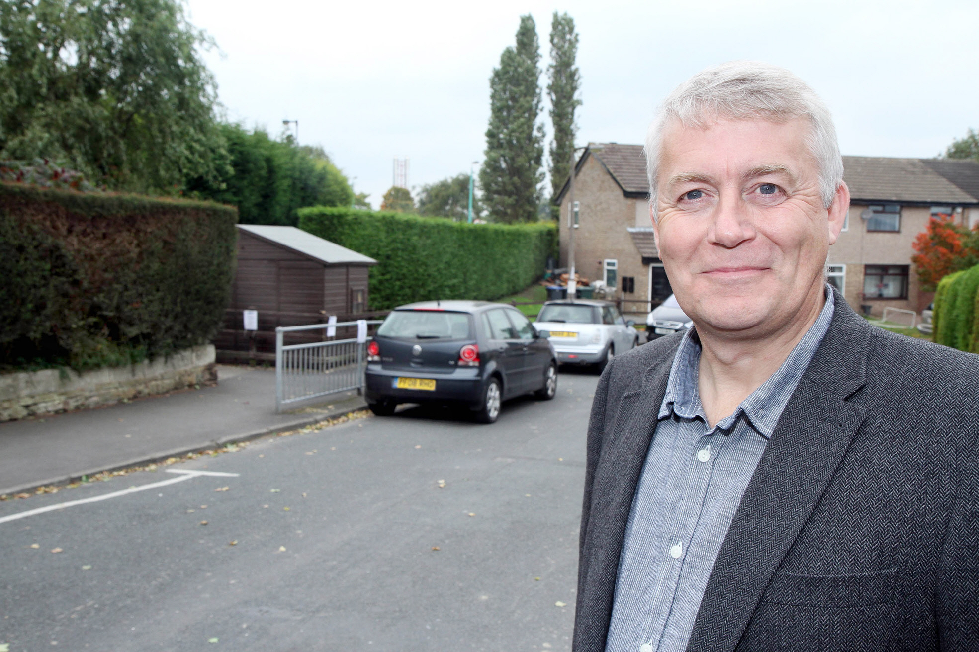Councillor Andrew Mallinson in Thornhill Road, where he has called into  question  extended plans for double yellow lines in a bid to tackle parking issues from the nearby Airedale Hospital