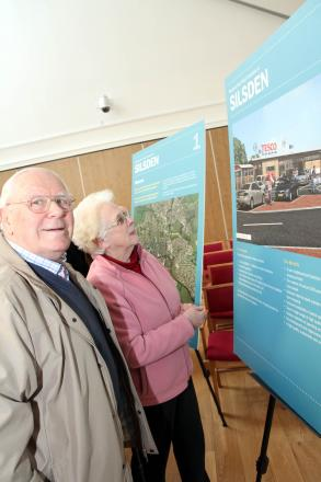 Silsden residents, Keith and Brenda Seymour, look at the exhibition of plans for a Tesco supermarket in the town