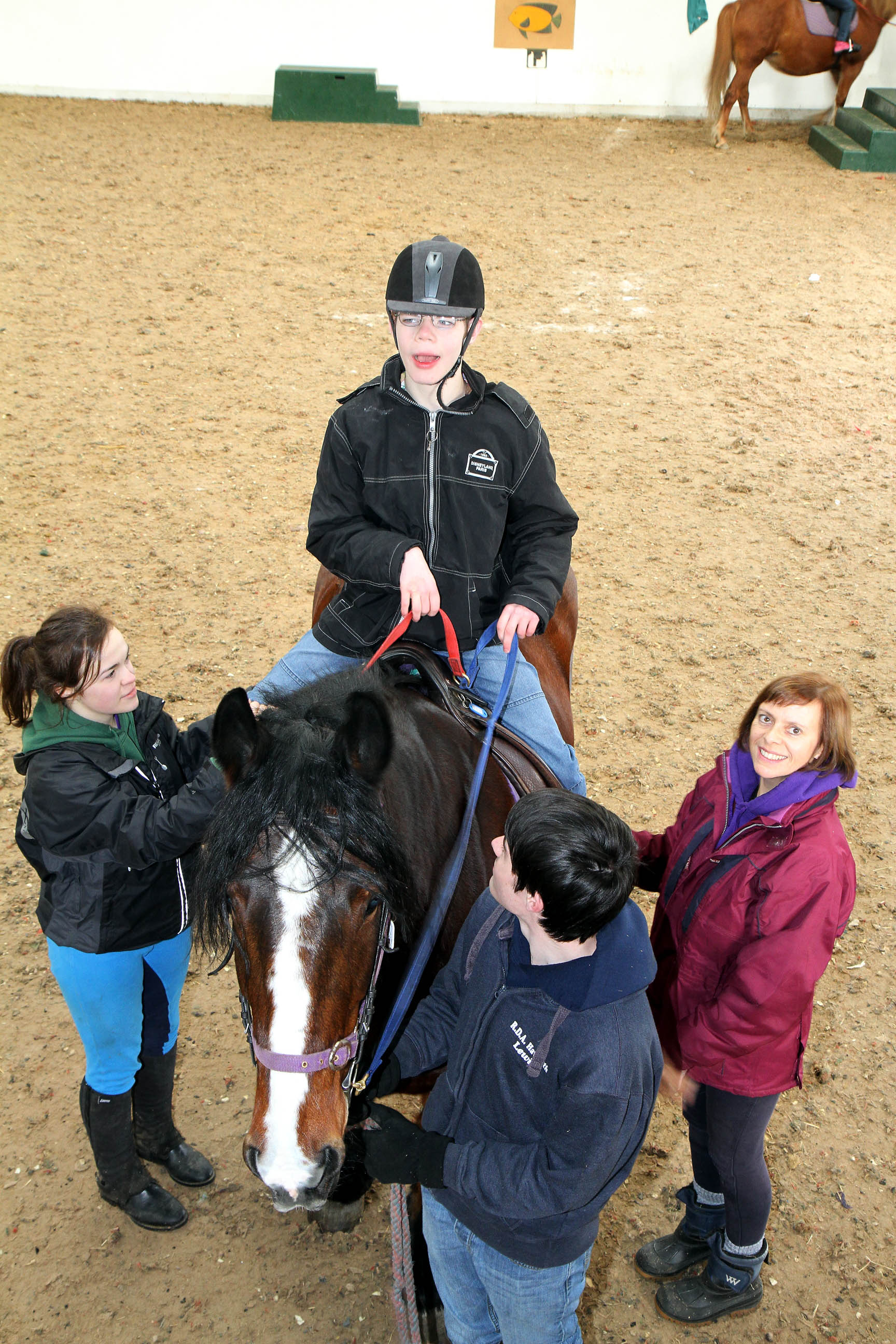 Noah Hinett on Chief at Haworth RDA, with, from left, Zoe Bell, Lewis Feather and Michelle Cranswick