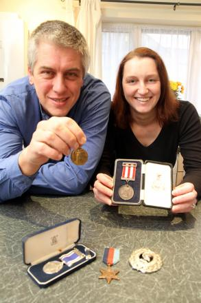 Silsden genealogists, Tim Hodge and Carole Bolton, with some of the medals given to him