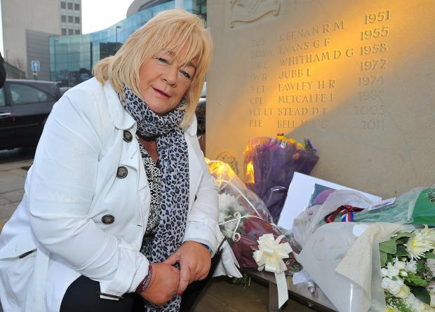 Elaine Bell at the memorial that includes the name of her son, Martin Bell,who was killed in 2011