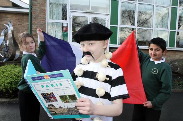 Keighley News: Shae Eckford, centre, prepares for the French trip with fellow Our Lady of Victories Primary Schoo