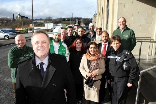 West Yorkshire Police and Crime Commissioner Mark Burns-Williamson (front) meets community members during his visit to the Emily Street mosque in Keighley