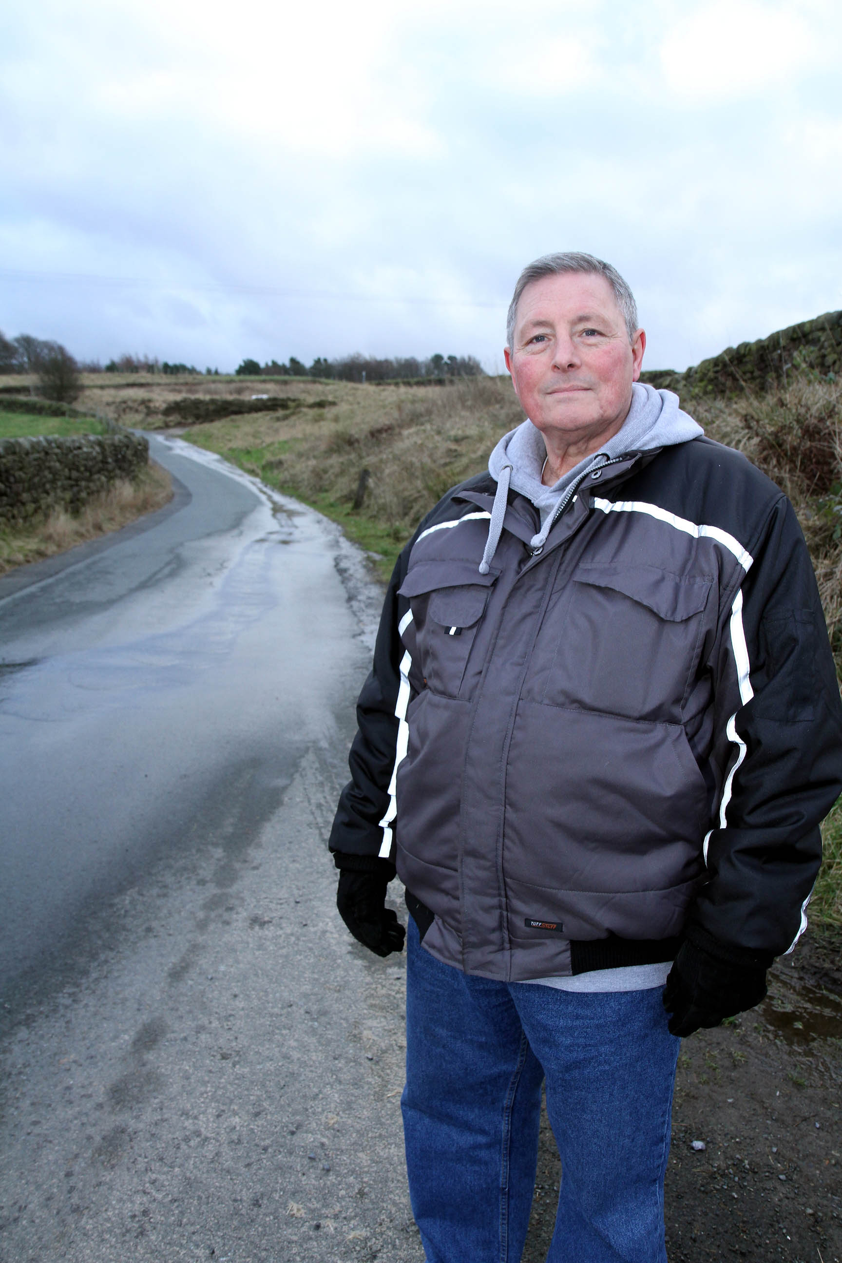 Howard Varley in Gill Lane, Newsholme, where he said the road floods on a regular basis