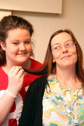 Katie Ingham, 14, and her mum, Sarah, above, who will have her head shaved to raise cash for her nephew Callum's appeal to help fund  his life-saving  surgery