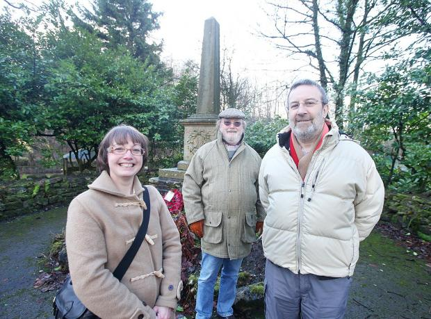 Keighley News: Lothersdale parish clerk, Esther Barrows, with councillors Eddie Cullen and parish council chairman Stephen Cohen at the war memorial they are hoping to restore