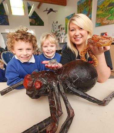 Caz Grundy, from Zoolab, is pictured (above) showing pupils Harry Dobson, Isabella Wright and Caz Grundy a corn snake and Australian tree frog