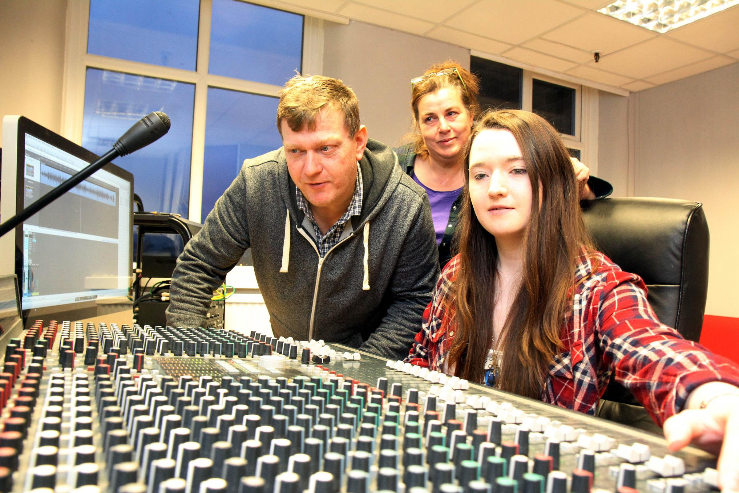 Laura Thornton, 18, at the Jam on Top studio controls, with owners Brian and Tracey Leach