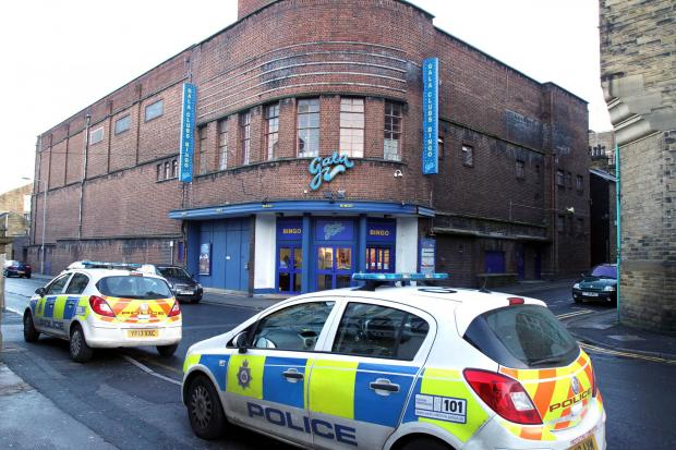 Police were called to the Gala Bingo premises in Alice Street, Keighley, on Friday afternoon after a man was seen on the roof of the building