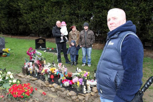 Michael Boddy at the grave of his wife, Carol