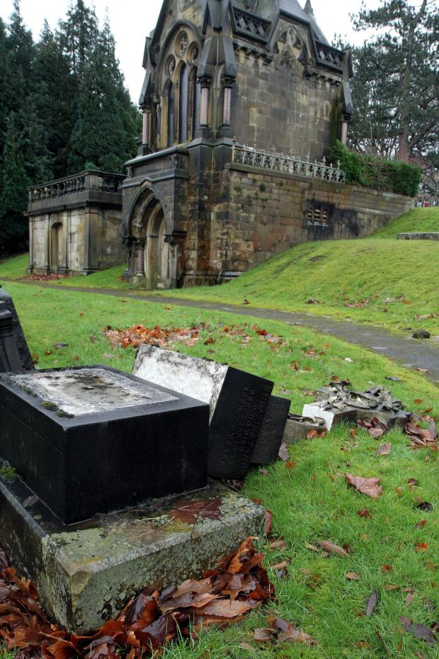 Keighley News: A vandalised headstone near the Butterfield family mausoleum in Utley Cemeter