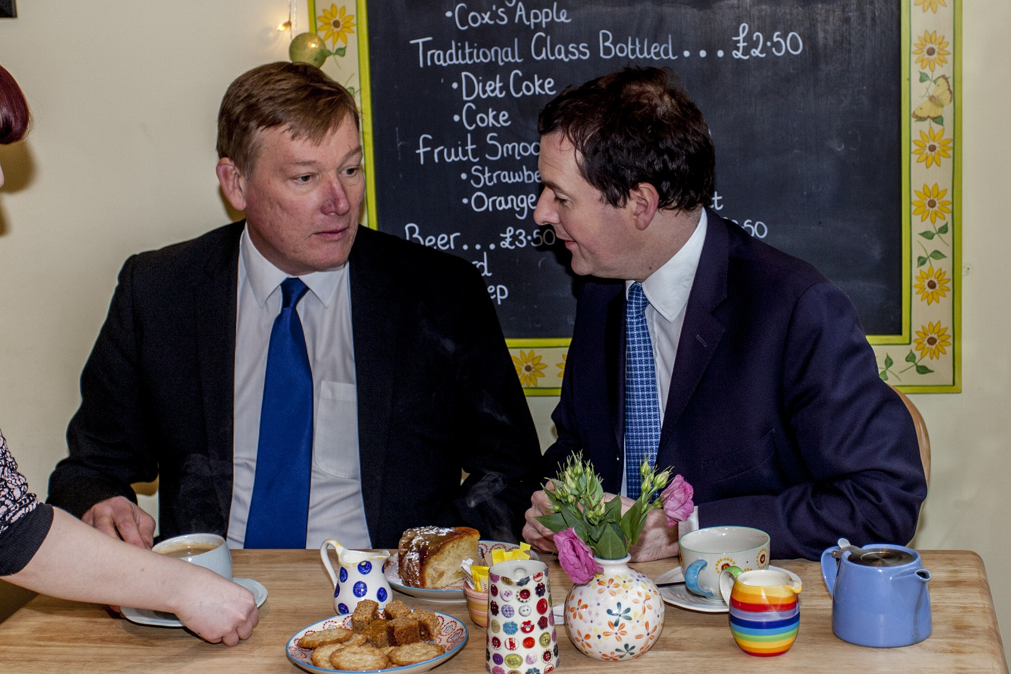 Hold on Kris, how do you spell Haworth? Chancellor George Osborne checks with Keighley MP Kris Hopkins during a tea break at Cobbles and Clay in the village 						       Picture by John Sargent