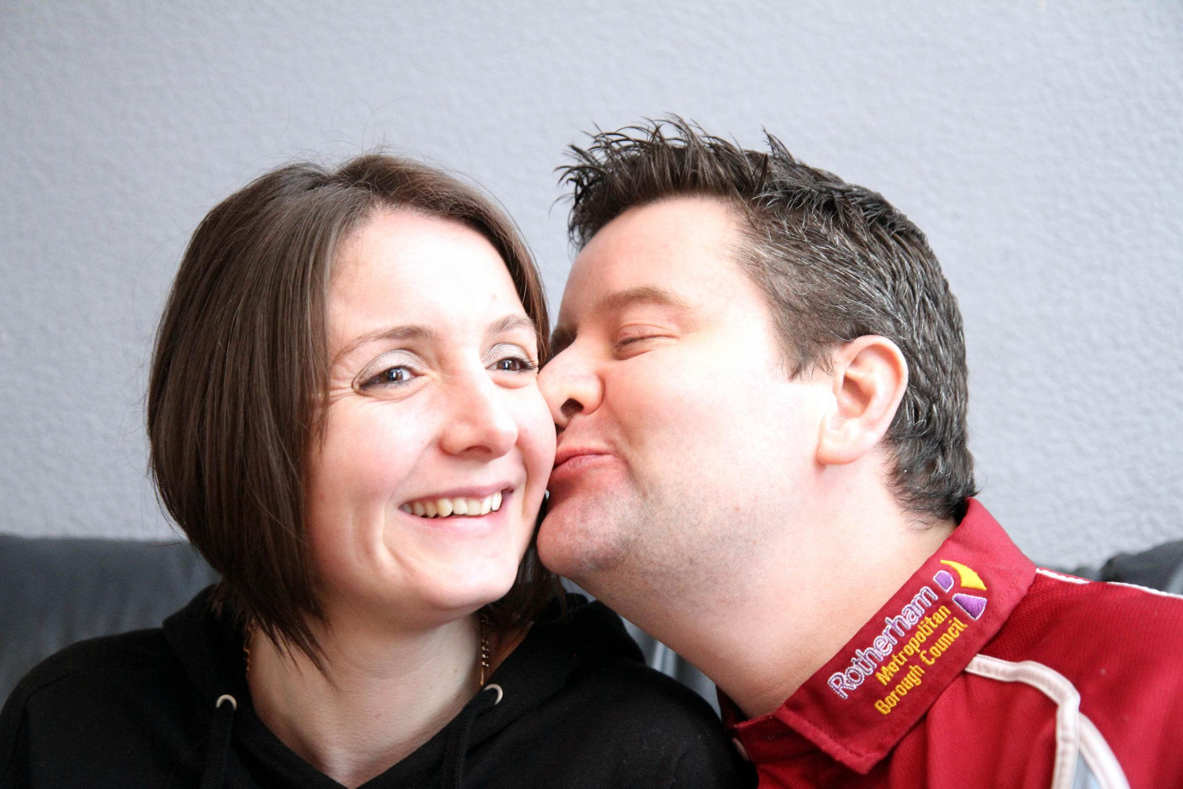 Keighley News Perfect Partners competition winners Sally and Tony Metcalf seal their success with a kiss