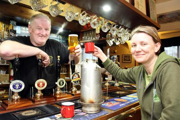 Annie Berrington toasts preparations for the new forest class with Brown Cow landlord, Barry Smith