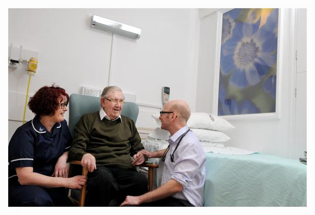 Keighley News: Airedale Hospital Ward 4 sister Sarah Robinson with patient Ronald Ford and consultant Robert Marshall
