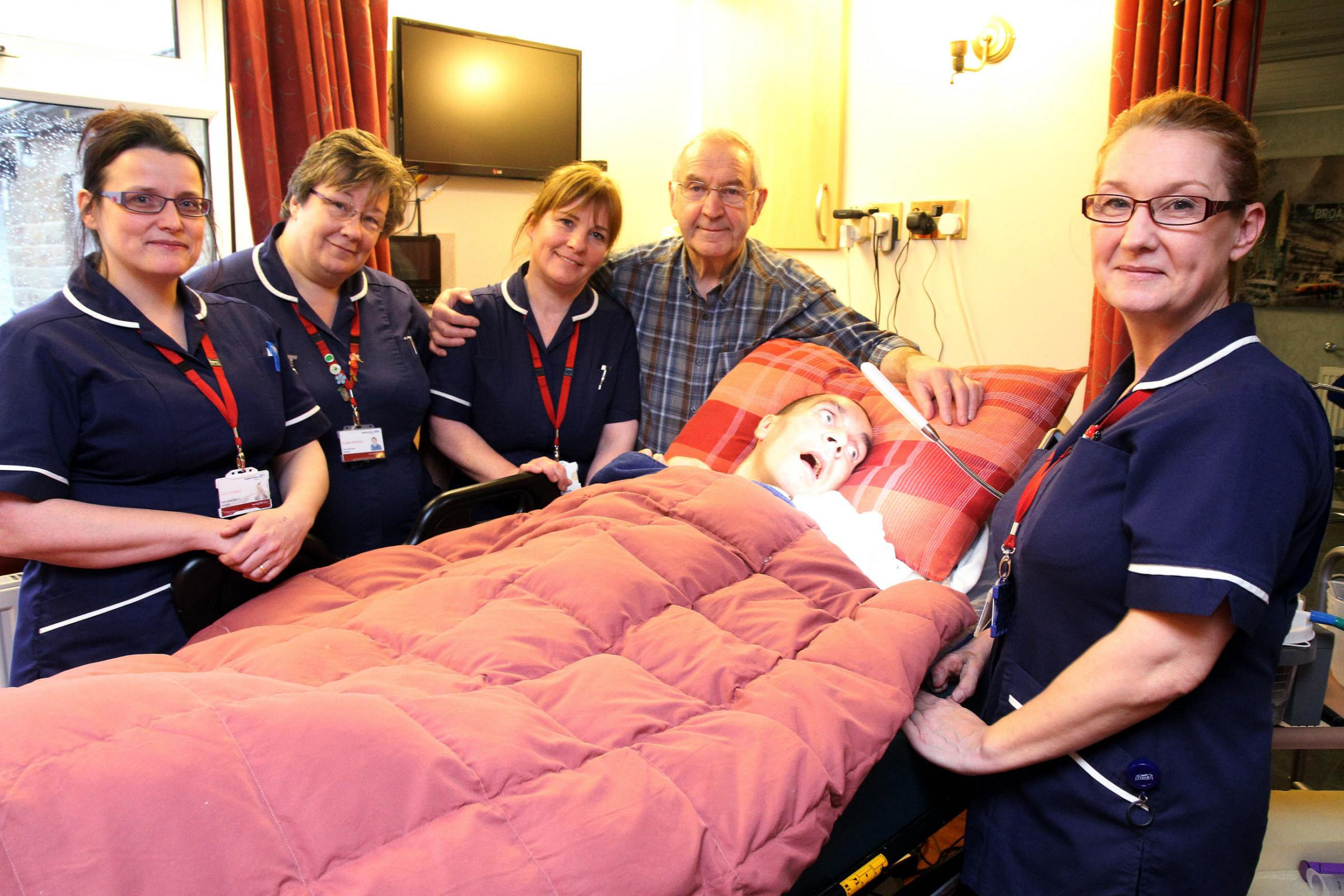 John Whitaker and son, Stewart, with the nursing team that looked after him,