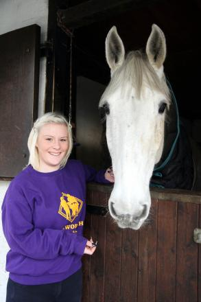Haworth Riding for the Disabled apprentice, Leonie Bradwell, with Blue at the stables