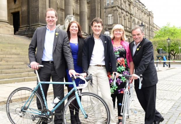 Paul Corcoran, centre, and Sandra Corcoran, second from right, owners of Pennine Cycles, with – from left – Tour de France director Christian Prudhomme, Caroline Towers and five-times Tour winner Bernard Hinault