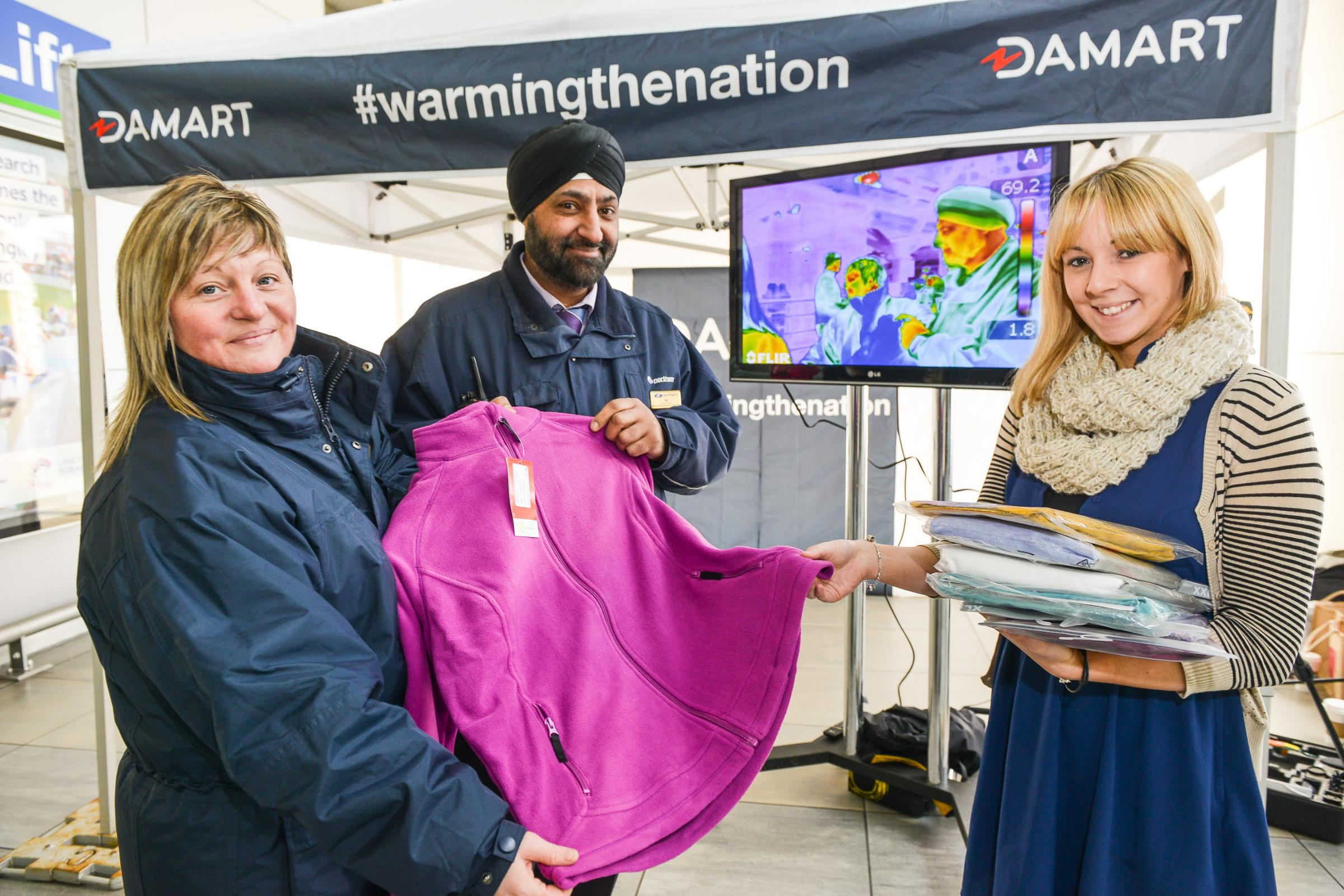 Northern Rail station staff Dawn Wilby and Raj Phull Phull with Damart's Rachel Firth