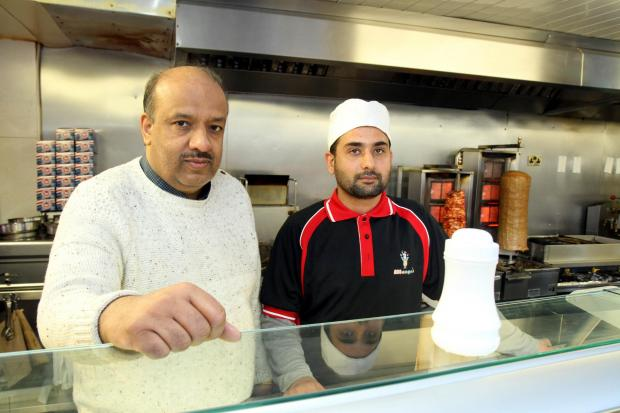 Mohammed Aslam, left, with Nadeem Iqbal at Mango's takeaway in North Street, Keighley