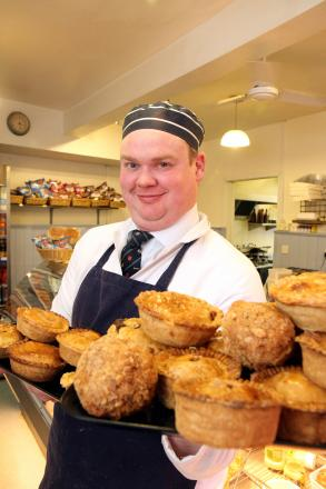 Brendan Ellison proudly displays some of the Cullingworth butcher's prizewinning pies