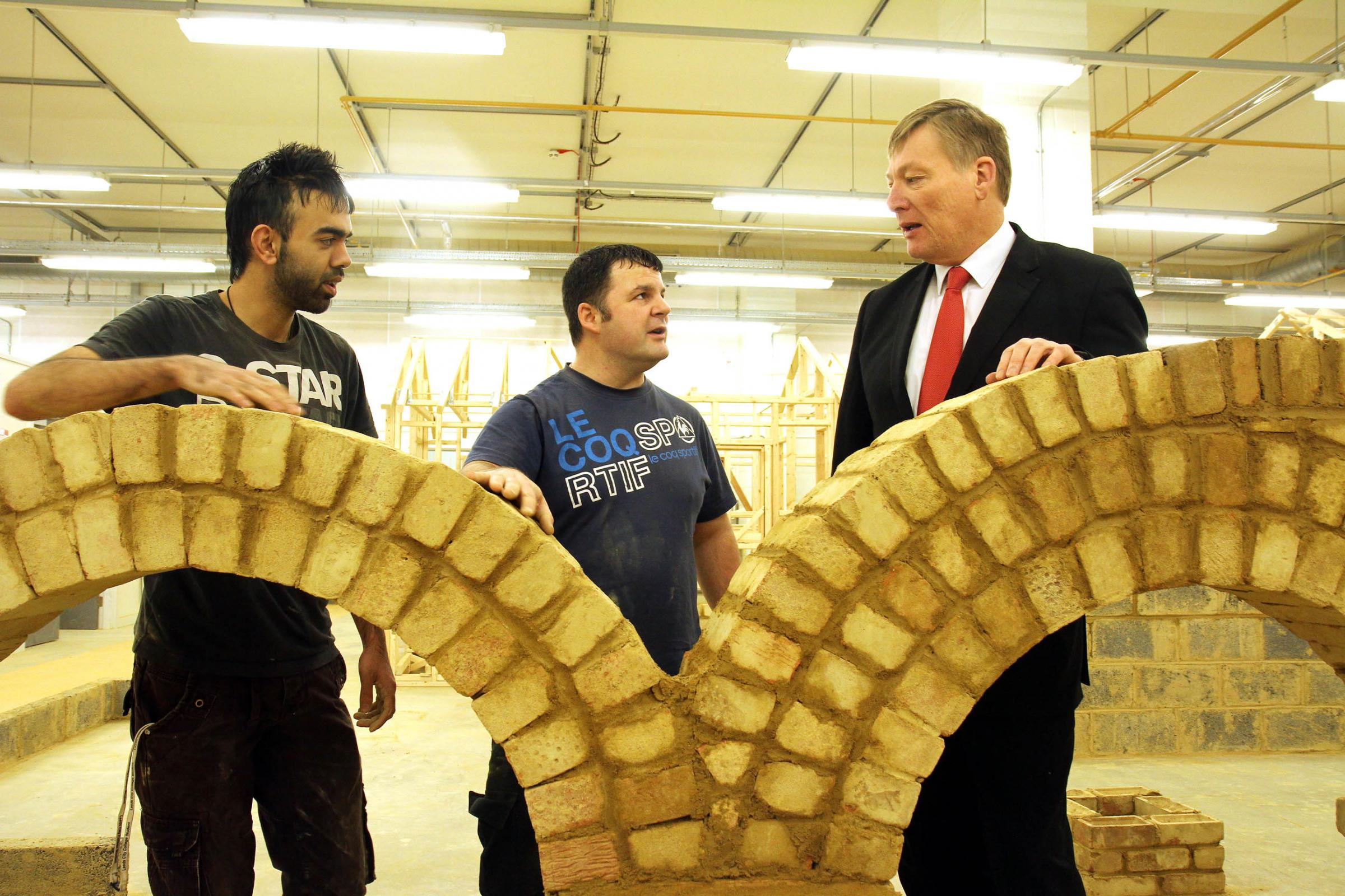 MP Kris Hopkins, right, talks to students Ibrahim Ali, left, and Martin Sutcliffe during his visit to Leeds City College Keighley Campus