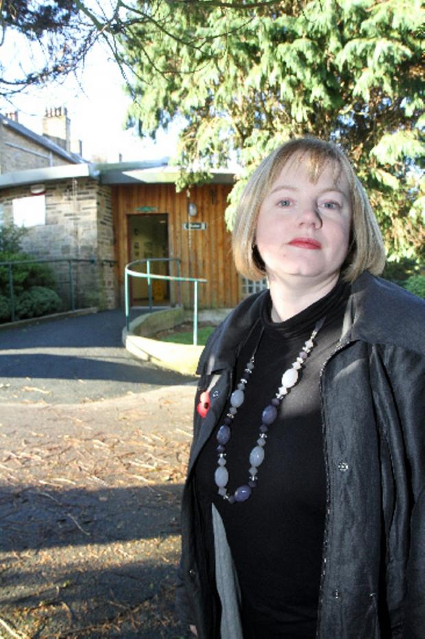 Keighley News: Worth Valley councillor Rebecca Poulsen outside the threatened Haworth toilets