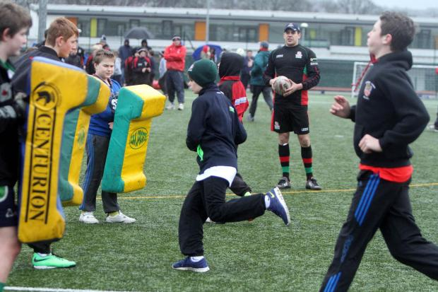 Keighley News: Albion youngsters are put through their paces as Cougars captain James Feather looks on