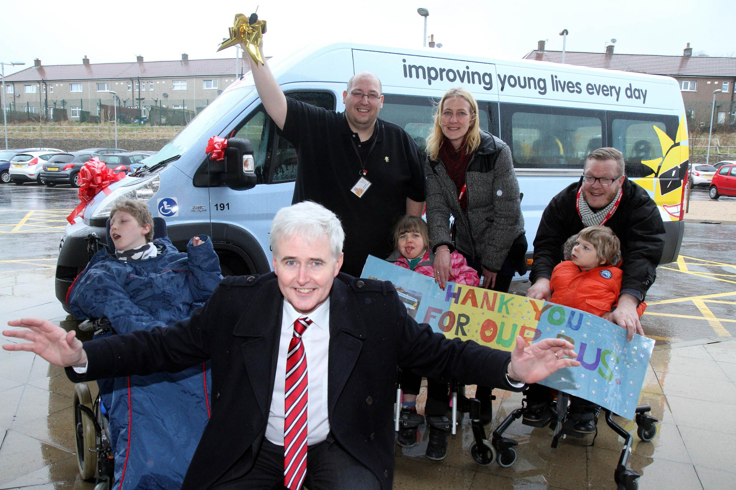 Jason Patefield (centre back), of Phoenix School, holds the keys to the new minibus with (from left), pupil Ben Ridehalgh, ten; Chris Kelly, treasurer of the Variety Club's Yorkshire committee; pupil Charlotte Savage-Tatterton, eight, with her mum, Elai