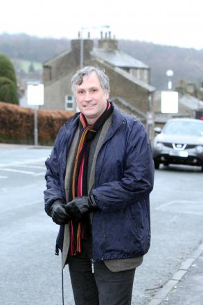 Councillor Simon Cooke in Hill End Lane, Harden, where a 40mph speed limit is planned