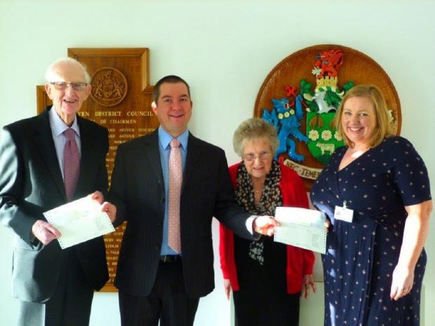 Councillor Chris Harbron, second from left, presents cheques to – from left – Allan Cawood and Margaret Whiteside, of Parkinson's UK, and Bronagh Daly, from Airedale Hospital