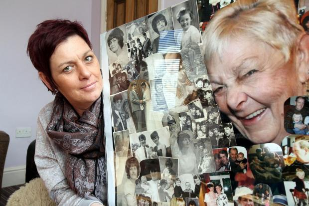 Rachel Sanderson with pictures of her late mother, Ann Holdsworth, who was cared for in Manorlands hospice at Oxenhope