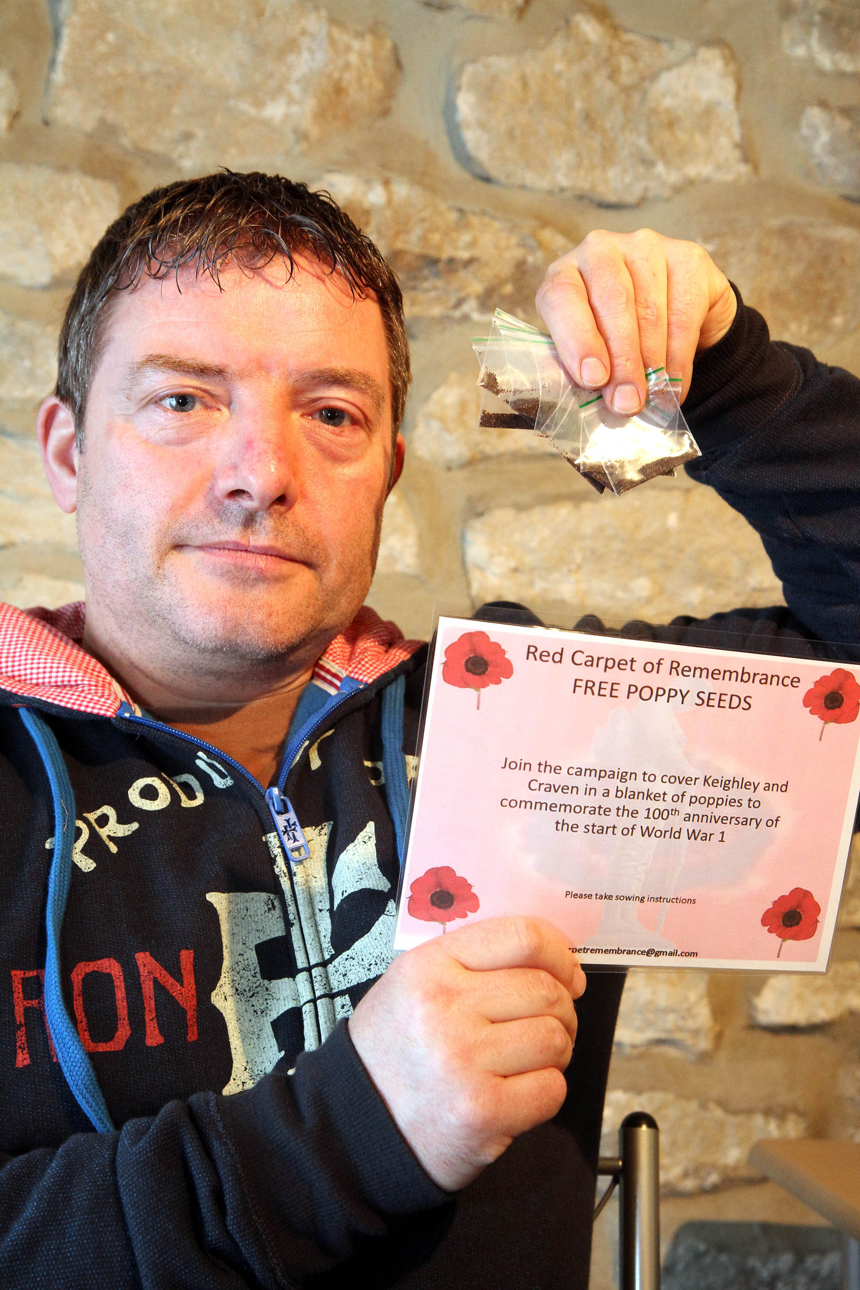 Andrew Hardaker with some of the poppy seeds he is donating to the public to mark the centenary of the start of the First World War