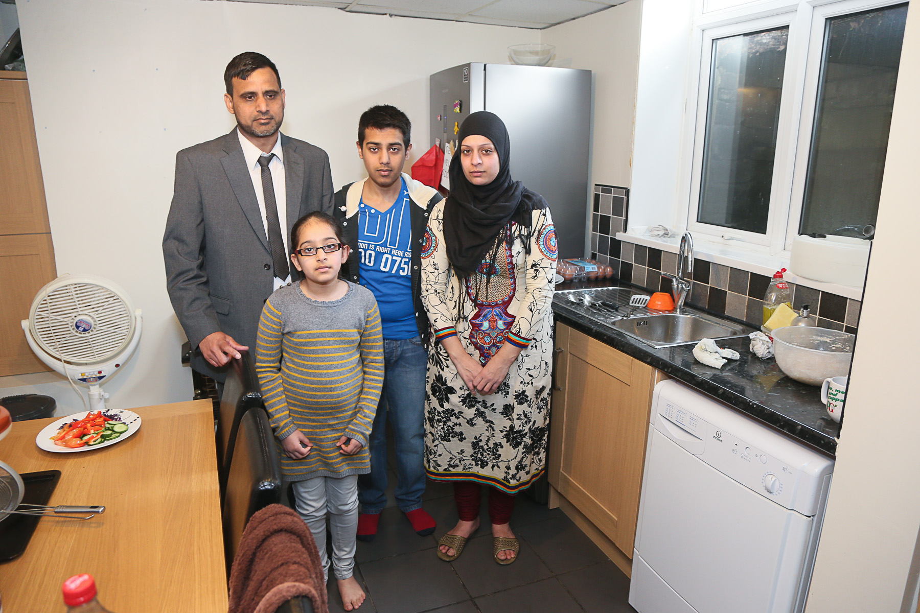 Councillor Khalid Choudhry, wife Shazia and children Qais and Husna in the kitchen of their Mannville Road home, which floods every time it rains