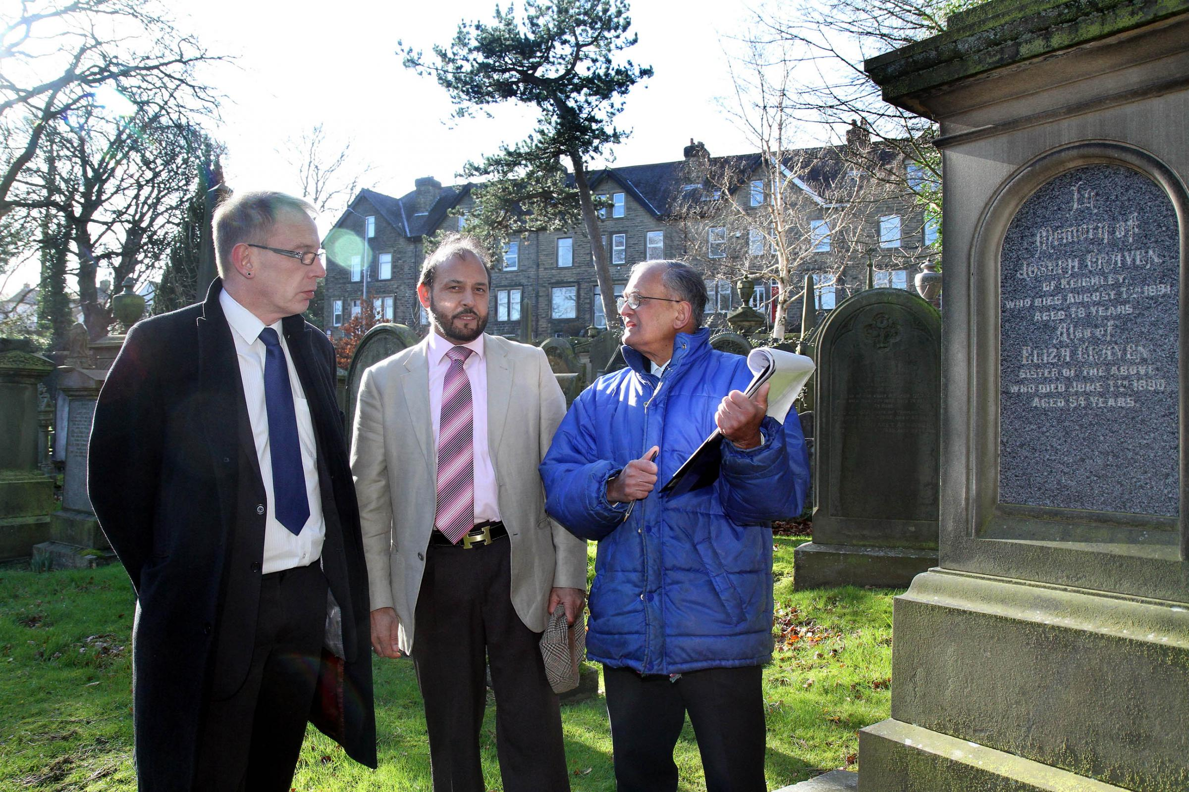 Bradford Council leader, Councillor Dave Green, left, and Councillor Abid Hussain, listen to concerns raised by Charlie Bhowmick at Utley Cemetery