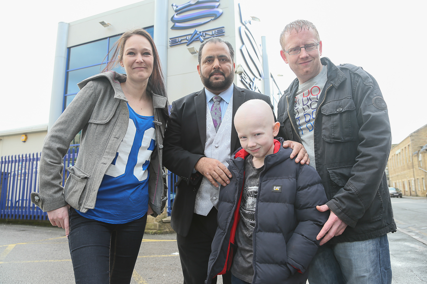 Mum Kim Ager, Javed Bashir, dad Matthew Ingham and Callum Ingham helping promote the Professional Muslims Institute fundraiser on behalf of the young cancer sufferer