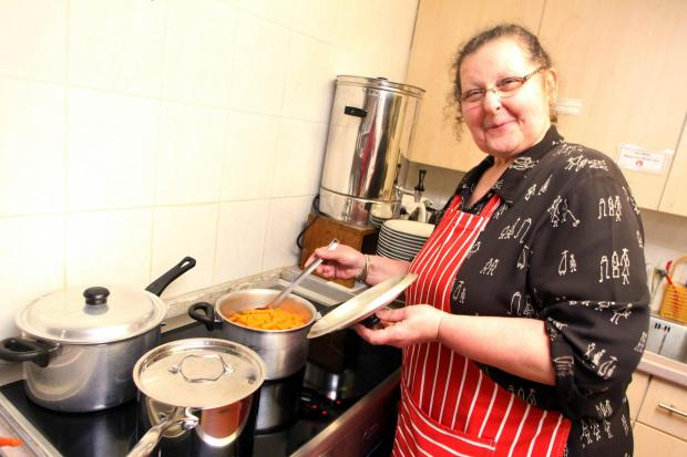 Keighley News: Irene Cyhanko cooks lunch for members of Keighley's Ukrainian community on the new cooker