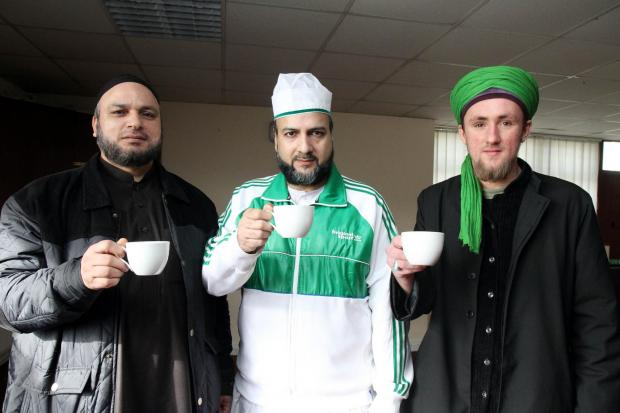 Keighley News: oining in the coffee morning at the Emily Street mosque community centre are, from left, Mohammed Yasin, chief administrator for Keighley Muslim Association; community relations and education officer, Mohammed Saleem; and lead spokesman, Daniel Attwood