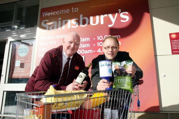 Sainsbury's Keighley charity co-ordinator, Duncan Turner, left, joins Keighley News editor, Richard Parker, to promote the trolley-load of goodies being raffled at the store on Sunday in aid of the Million for Manorlands campaign appeal