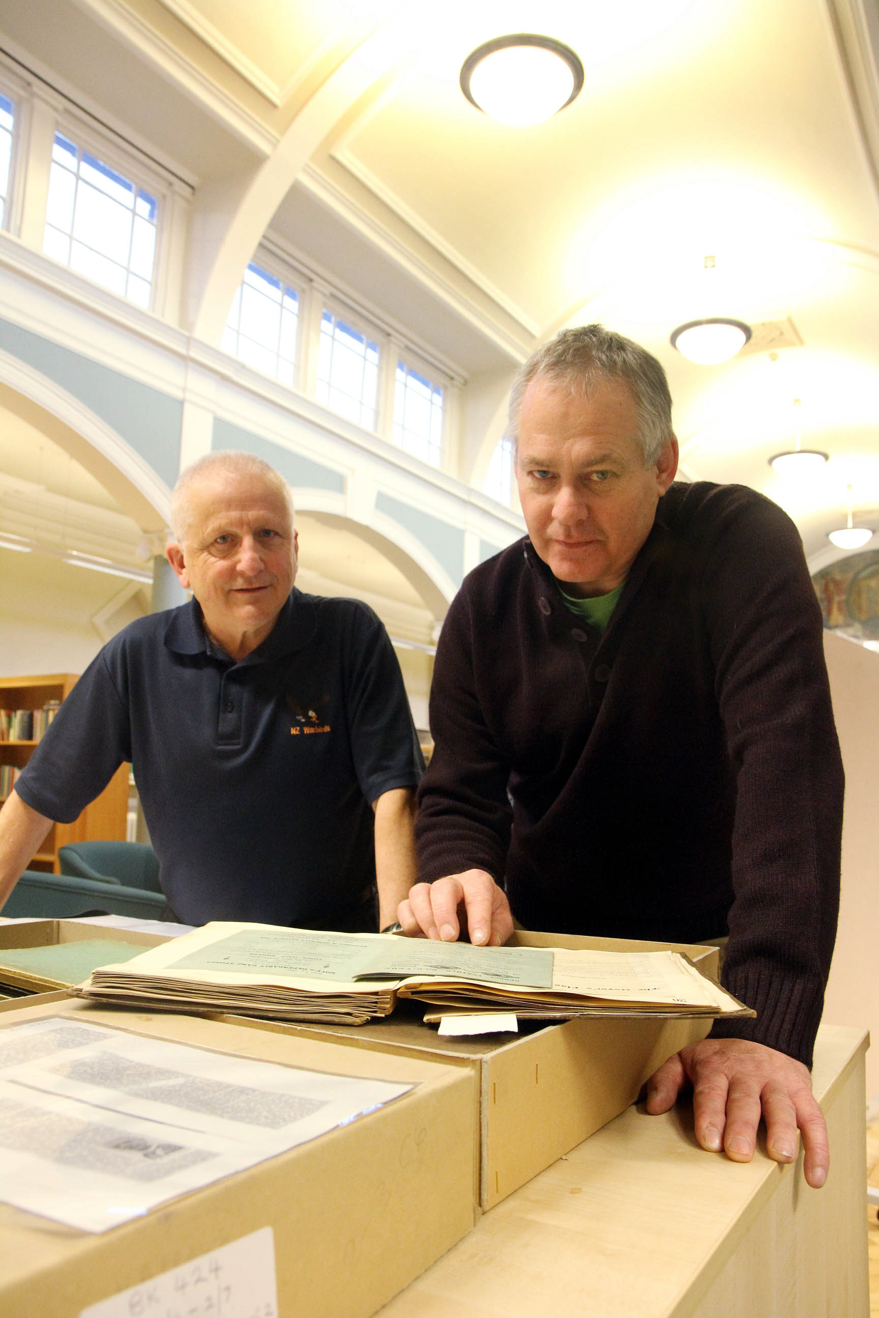 Andy Wade, right, and Ian Walkden, from Men of Worth, look at First World War archives in Keighley library