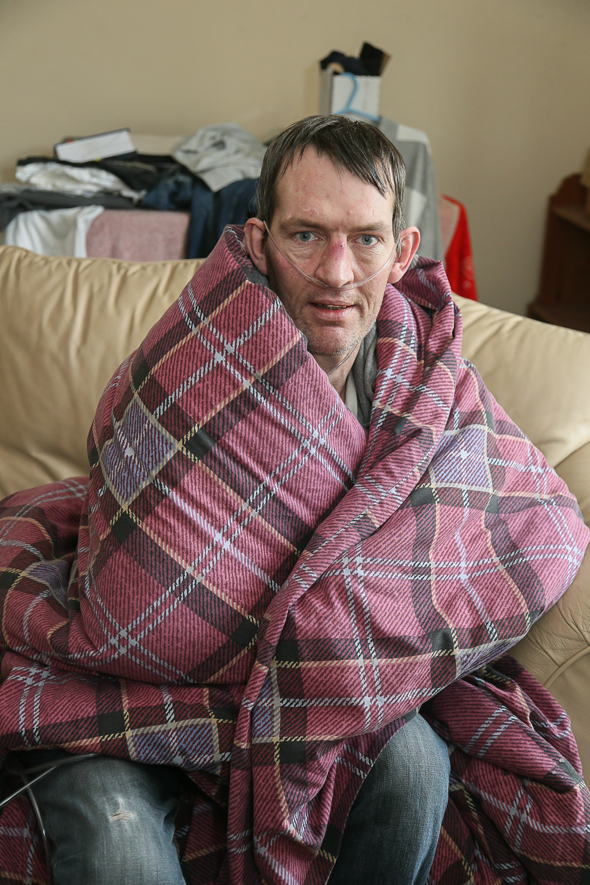 Joseph Burke wrapped up in a quilt while waiting for repairs to be carried out to his gas fire