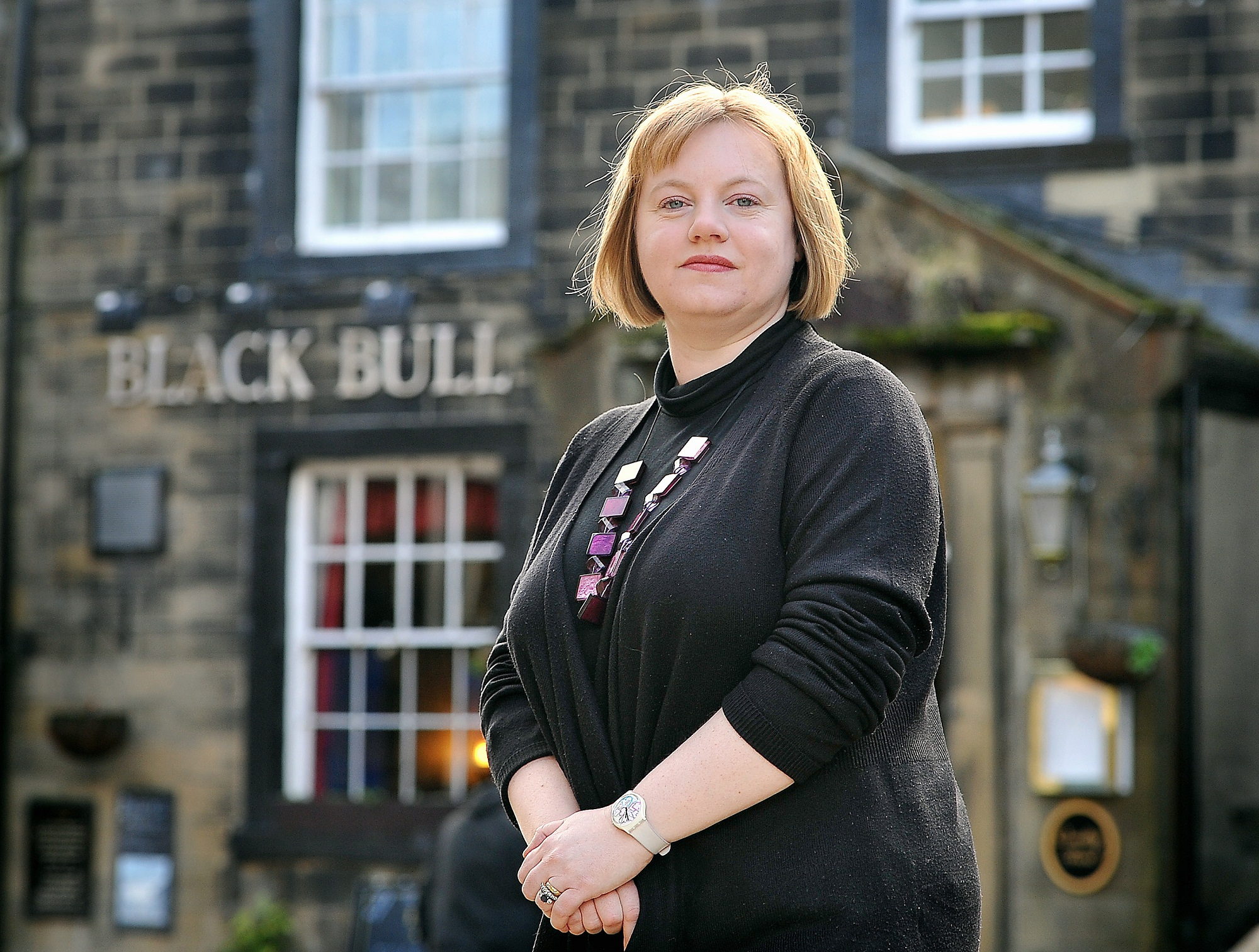 Councillor Rebecca Poulson outside the Black Bull pub in Main Street, Haworth, which it is feared could close unless a new tenant can be found