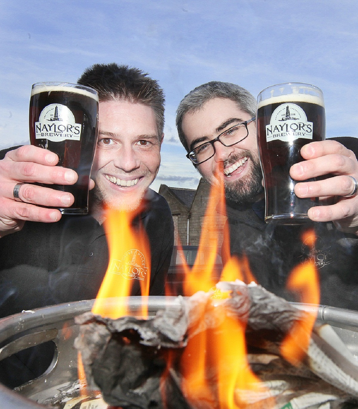 Sales director, Michael Wilkinson, and owner, Robert Naylor, at the launch of Naylor's Brewery's new smoked beer, called Twisted Kour