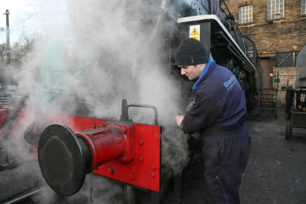 Tom Kay makes some final alterations to steam engine Big Jim