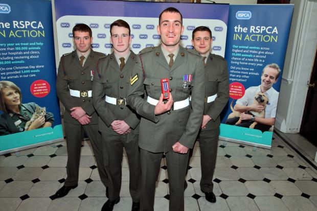 Marines David Willers, Chris Mahomet, Corporal Chris Westbury and Henry Mitchell at the RSPCA awards ceremony. Picture courtesy of the RSPCA